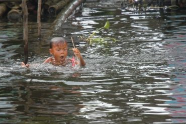 cambodia boy in the river