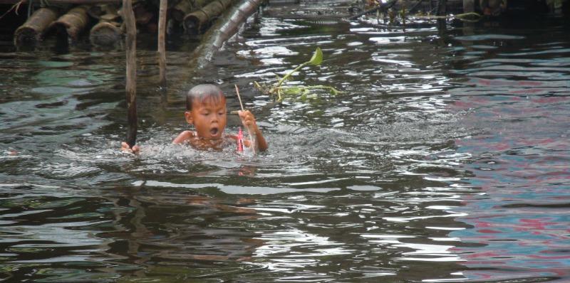 cambodia boy in the river